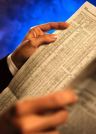Stock ticker from newspaper