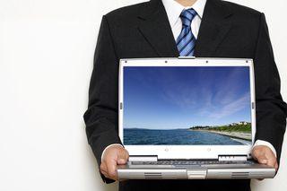 Man holding computer