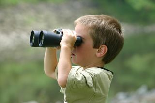 Boy birdwatching